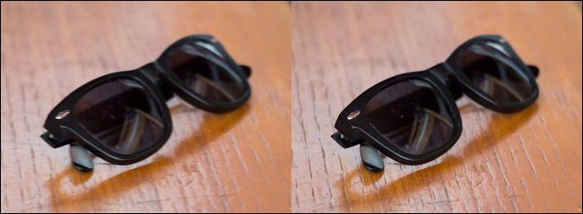 Two images of a pair of sunglasses on table, one blurry and one clear.