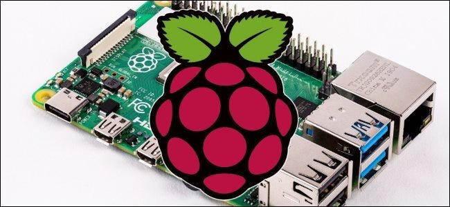 A Raspberry Pi and its official raspberry logo.