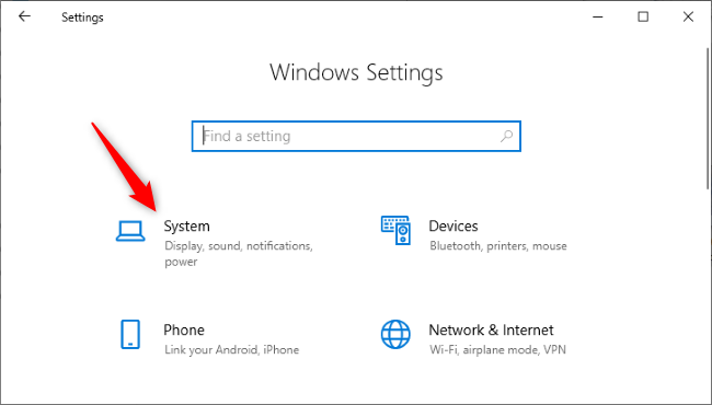 "Clicking the ""System"" icon in Windows 10 Settings."