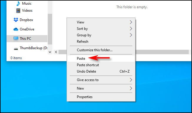 """In the destination window, right-click and select """"Paste"""" from the pop-up menu in Windows 10."""