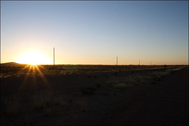 An unedited RAW image of a sunset with dark shadows and bright highlights.