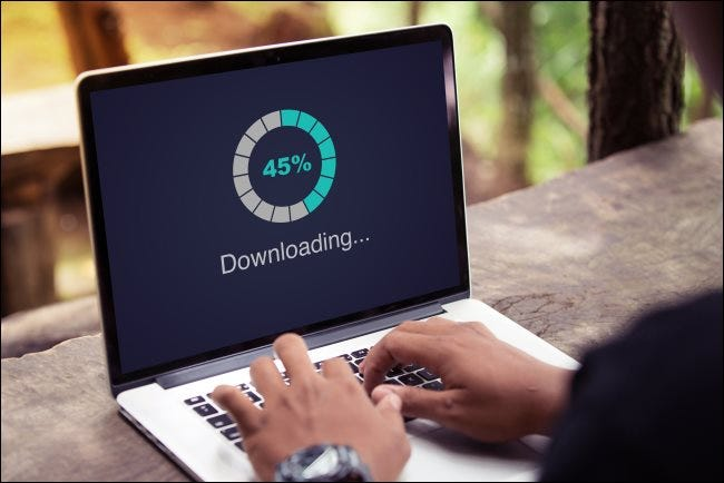 "A ""Downloading"" progress meter on a laptop."
