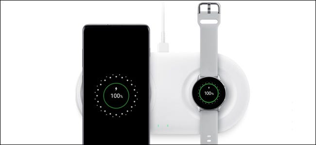 A Samsung phone and watch on a charging Pad.