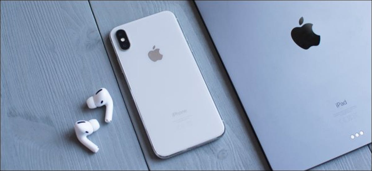 AirPods next to an iPhone and iPad