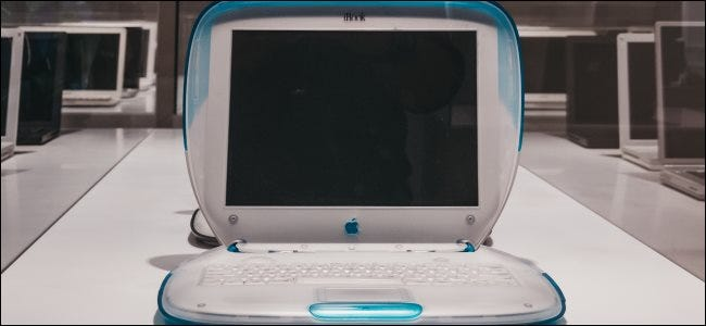 An Apple iBook laptop in a museum.