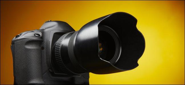 A digital camera with a lens hood.