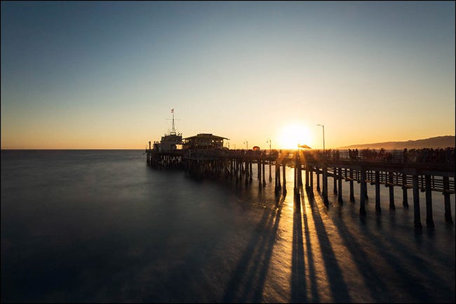 A pier at sunset with a creative adjustment of white balance.