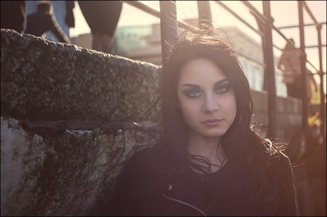 Portrait of a girl with the sun behind her, creating lens flare.