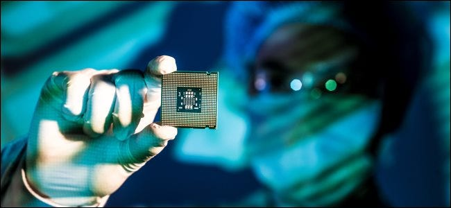 An engineer holding a computer chip.