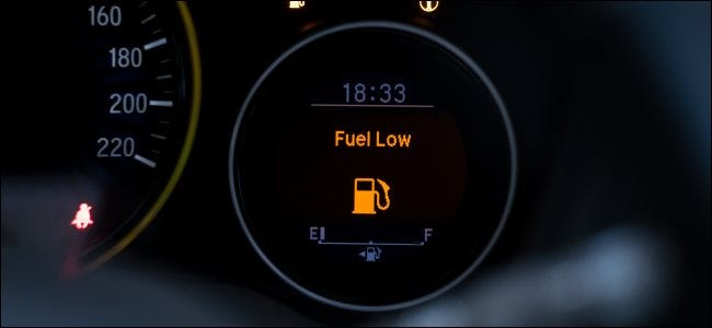 """A """"Fuel Low"""" message on a gas gauge."""