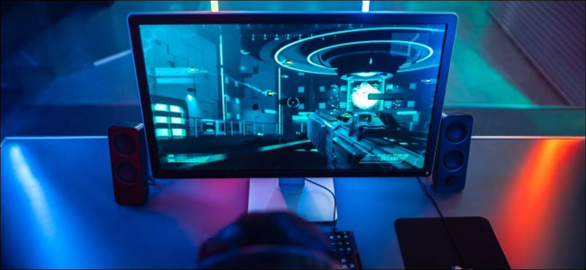 A person playing a first-person game on a gaming PC.