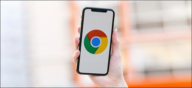 Someone holding an iPhone with the Chrome logo onscreen.