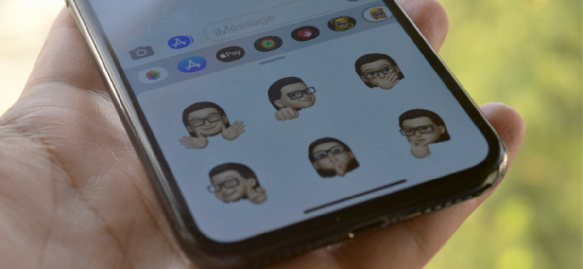 iPhone User Using Memoji Stickers