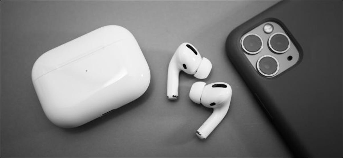 AirPods Pro next to an iPhone 11 Pro.