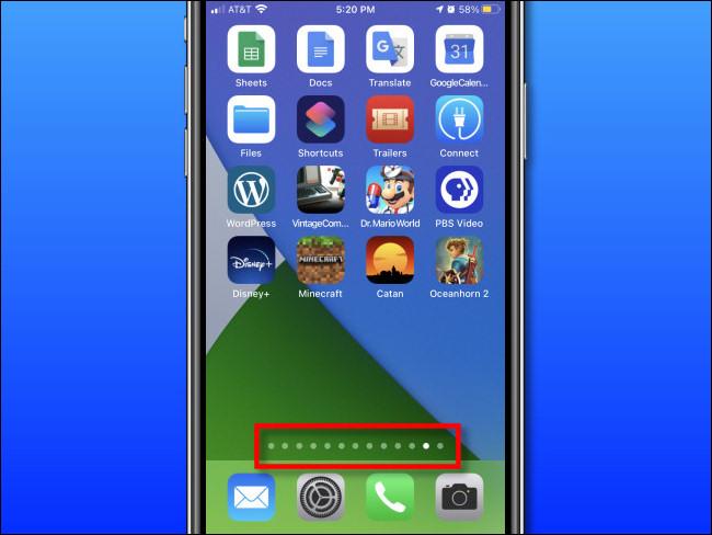 Los puntos de la página de la pantalla de inicio sobre el Dock en un iPhone.
