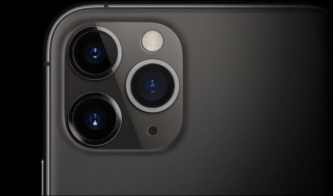 The triple lenses on an iPhone 11.