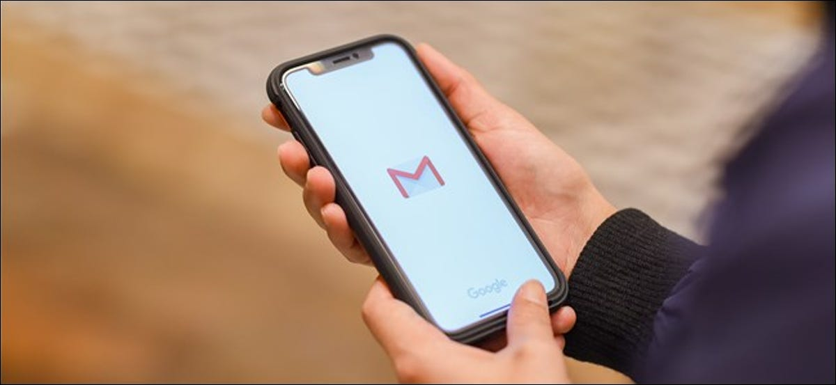 The Gmail logo on an iPhone.