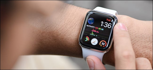 Person using their Apple Watch with complications