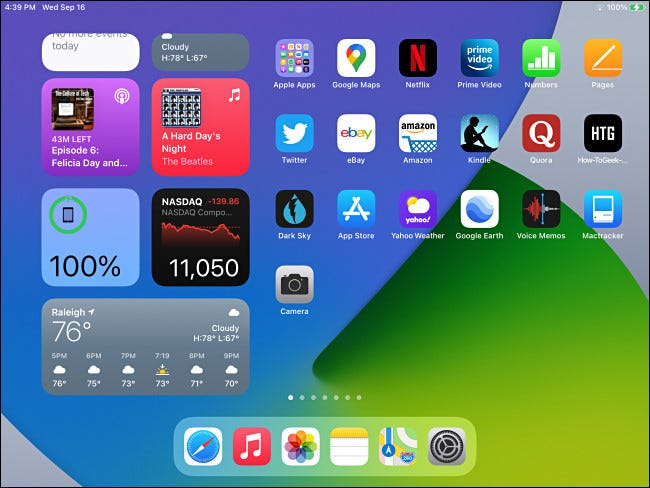 The iPadOS 14 home screen with Today View widgets visible.