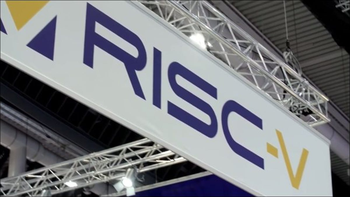 An RISC-V logo sign at a conference.