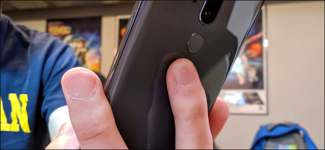 Someone's finger on the back of an Android phone.
