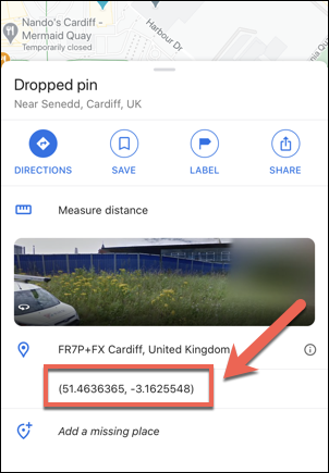 The coordinates of the Welsh Parliament, UK, displayed in the Google Maps app on iPhone.