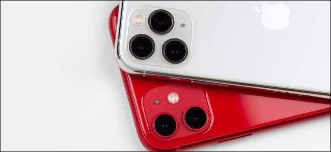 A red iPhone 11 and silver iPhone 11 Pro.
