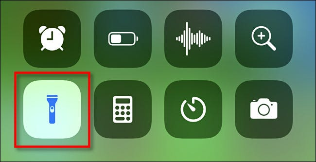 Tap the flashlight icon in iPhone Control Center to turn it off.
