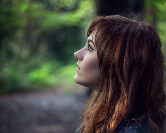 Portrait of a woman in profile looking upward.