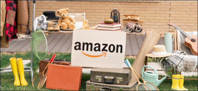 A yard sale with an Amazon yard sign set up in the middle.