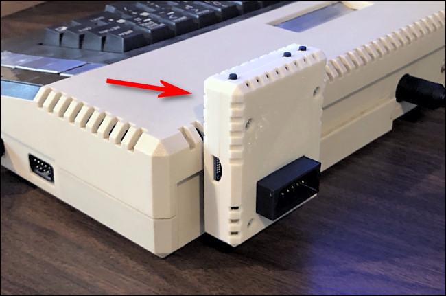 A FujiNet adapter plugged into an Atari 800XL.