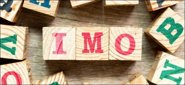 """""""IMO"""" spelled out with wooden blocks."""