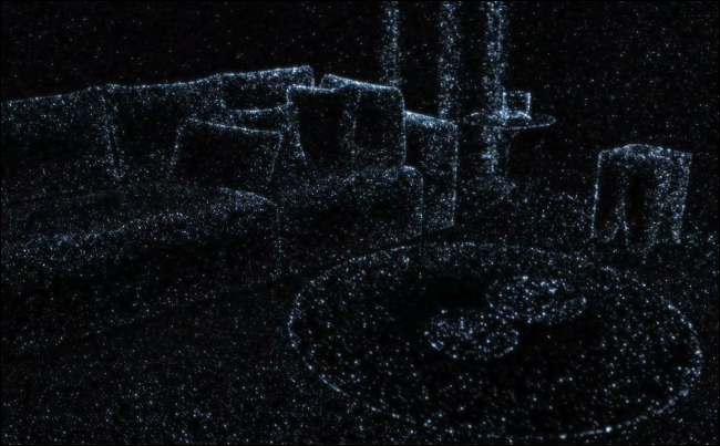 A living room with furniture outlined by dots, showing what the iPhone LIDAR scanner sees.