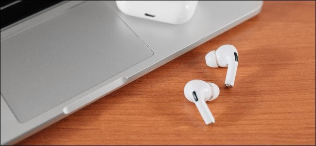 AIrPods Pro next to a MacBook touchpad.