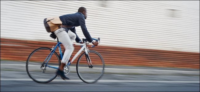 A man riding a bicycle on a city street.