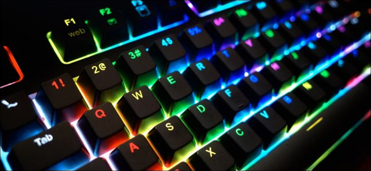 A glowing PC keyboard with rainbow LEDs.