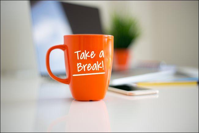 "An orange coffee mug with ""Take a Break!"" printed on it."