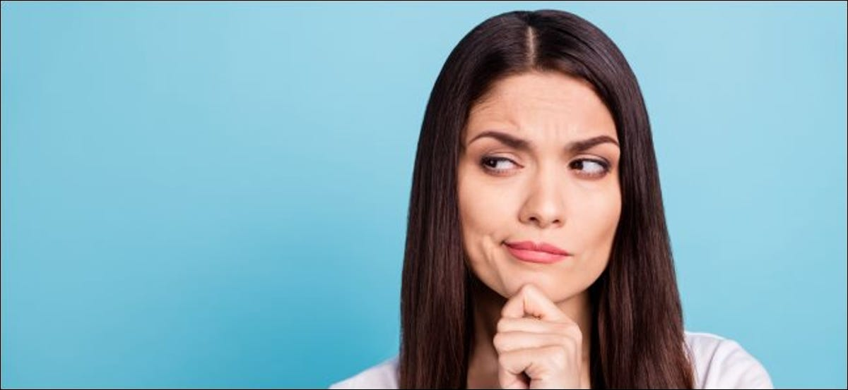 A woman with a suspicious, questioning facial expression.
