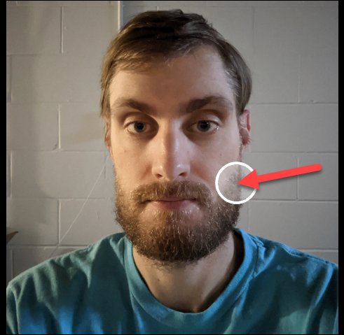Drag the circle where you want it to adjust the lighting in an image.