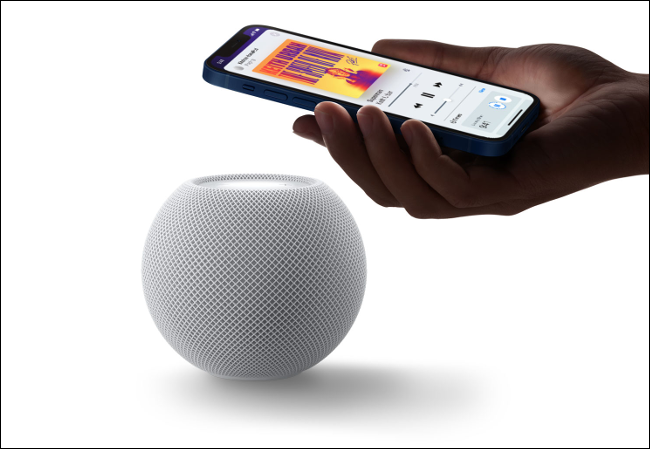 Someone transferring music playing on an iPhone to a HomePod.