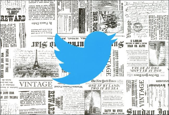 The Twitter logo over some vintage newspapers.