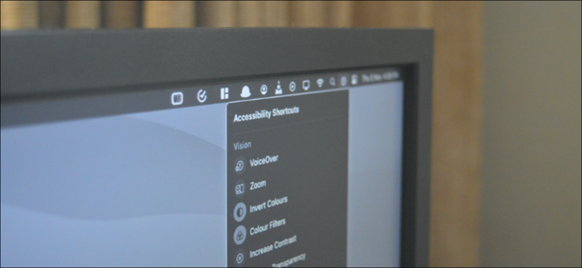 Mac User Accessing Accessibility Shortcuts from Menu Bar