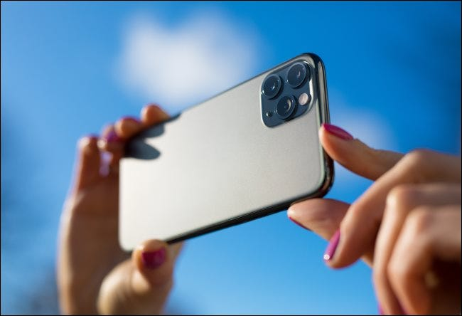 A person taking a photo with an iPhone