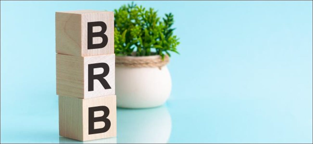 """The letters """"BRB"""" spelled out in wooden blocks."""