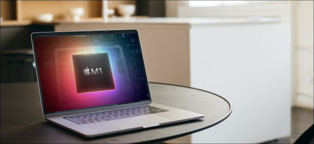 A MacBook with an M1 chip logo on its screen.