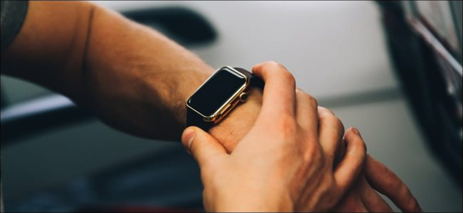 A man using an Apple Watch on an airplane.