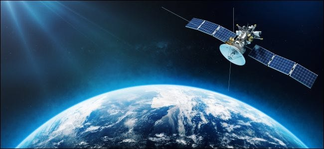 An artist's rendering of a satellite orbiting the Earth.