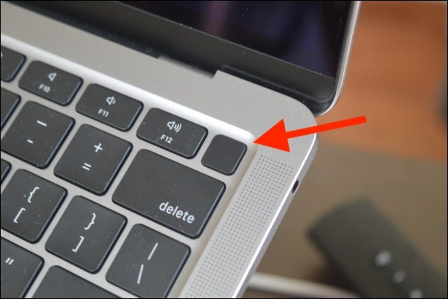 Press and Hold Power Button on MacBook