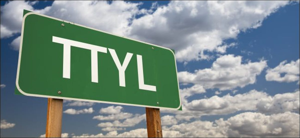 """""""TTYL"""" on a sign with the sky in the background."""