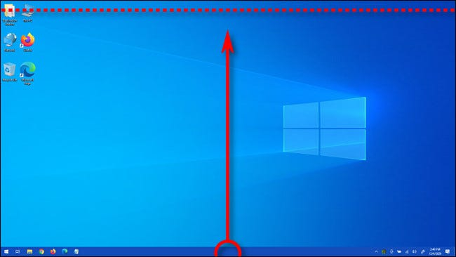 With the taskbar unlocked, drag it with your mouse to the top of your screen and release the mouse button.